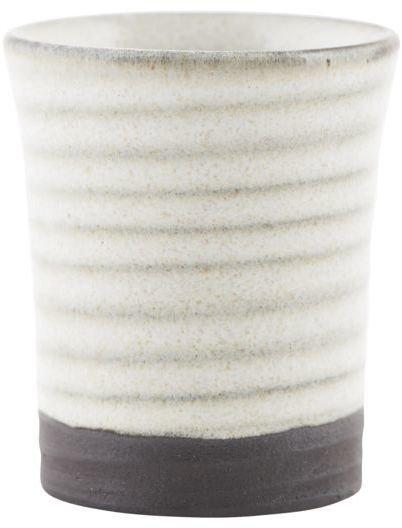 På billedet ser du variationen fra brandet House Doctor i en størrelse D: 4 cm. x H: 5,5 cm. i farven Sand