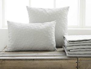 Kategoribillede til tæpper og tekstiler, der giver en fantastisk hygge i hjemmet