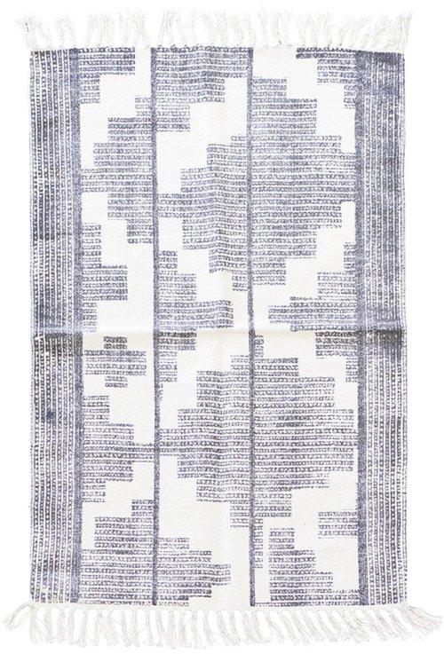 På billedet ser du Tæppe, Eve fra brandet House Doctor i en størrelse 60 x 90 cm. i farven Sort/Hvid