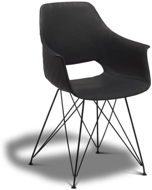 På billedet ser du et stemningsbillede (#7) fra Hereford, Spisebordsstol, PU-læder fra brandet Raymond & Hallmark i en størrelse H: 85 cm. B: 57 cm. i farven Sort