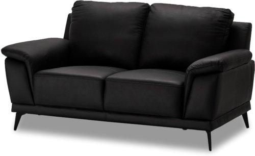 På billedet ser du et stemningsbillede (#7) fra Dunblane, 2 personers sofa, Læder fra brandet Raymond & Hallmark i en størrelse H: 89 cm. B: 169 cm. i farven Sort
