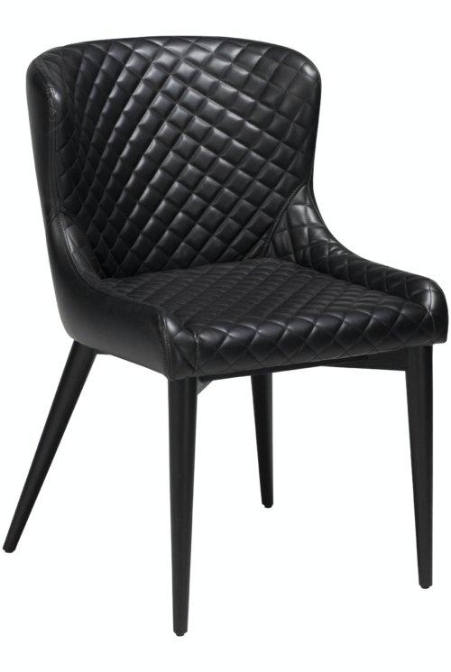På billedet ser du variationen Vetro, Spisebordsstol, Kunstlæder fra brandet DAN-FORM Denmark i en størrelse H: 80 cm. B: 50 cm. i farven Sort