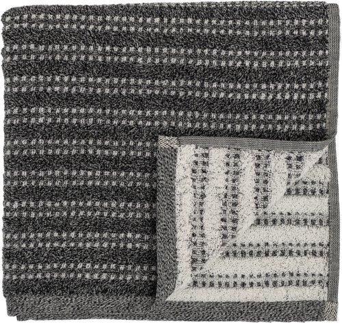På billedet ser du variationen Cozy, Håndklæde, Bomuld fra brandet Bloomingville i en størrelse B: 70 cm. L: 140 cm. i farven Sort