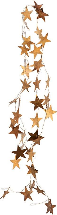 På billedet ser du variationen Ornament, Stars fra brandet House Doctor i en størrelse L: 250 cm. i farven Messing