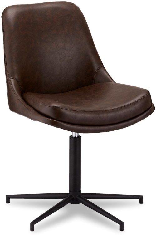 På billedet ser du variationen Limerigg, Spisebordsstol, PU læder fra brandet Raymond & Hallmark i en størrelse H: 89 cm. B: 59 cm. L: 64 cm. i farven Mørkebrun